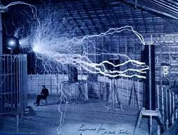 Nikola Tesla sitting in his lab